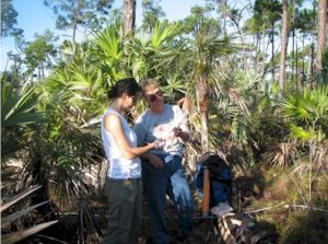 Jefferson Middle School science teacher Ann McGhee (right) assists IQPR M.S. student Niki Garland collecting cores from slash pines in the Florida Keys.