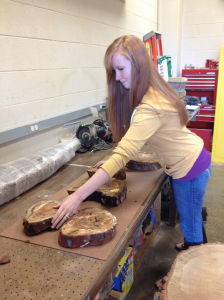 Undergraduate geography major Brooke Pearson (above) processes wood samples in the wood shop of the Laboratory of Tree-Ring Science.