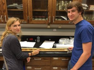 Undergraduate geography majors Lizzie Maclennan and William Maples (above) process sediment from a core collected at Keener Bog in northern Georgia.