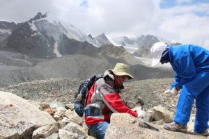 Dr. Philip Li collects rock samples on Holocene moraines in the Tian Shan Mountains of China.